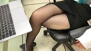 Office young gentleman legs in black pantyhose together with heels