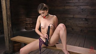 Naughty babe Kristen Scott is testing pioneering sexual intercourse toy in the dark BDSM room